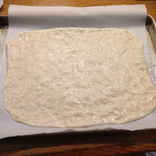 roll out one of the other dough balls on a 1/2 sheet pan lined with parchment paper