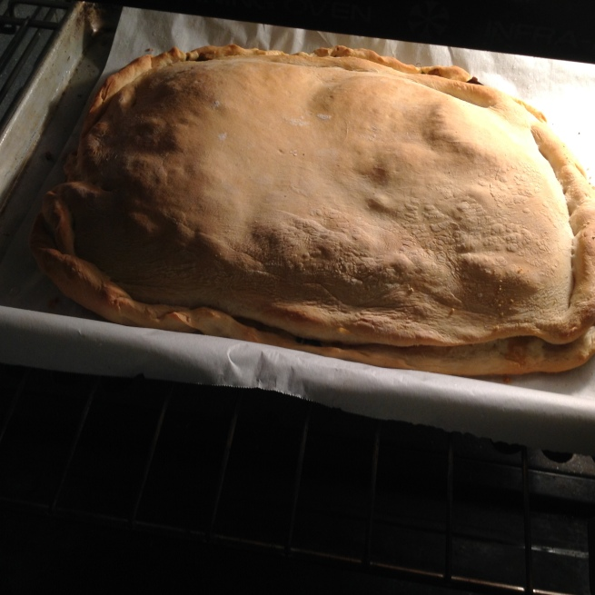 bake the calzone and bread...